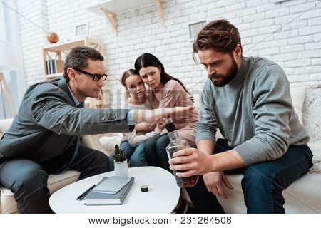 Psychologist Does Not Allow Bearded Man To Drink Alcohol, Near Which Wife And Daughter Are Sitting.