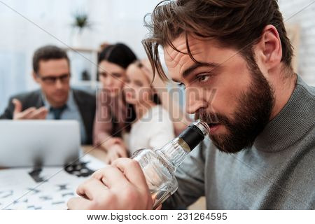 Close Up. Bearded Man Drink Alcohol With Family At Psychologist Office. Problem Of Father Of Alcohol