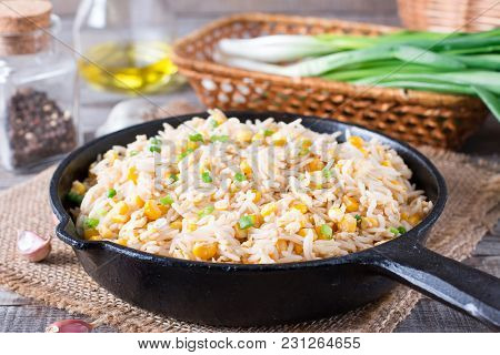 Fried Rice With Egg. Prepared And Served In A Frying Pan. Fried