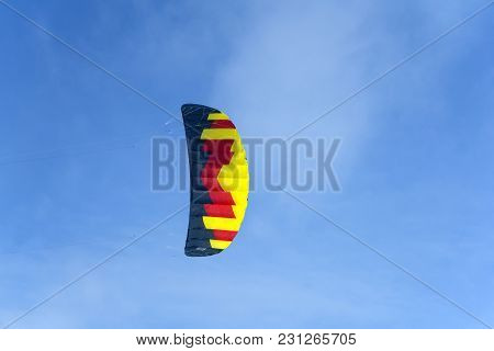 Bright Multicolored Sports Kite For Kiting Or Snowkiting Against The Blue Sky