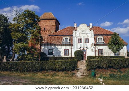 Liw, Poland - September 12, 2004: Manor House Office And Tower Of Gothic Castle In Liw Town In Masov