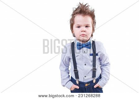 A Little Boy In A Blue Bow Tie And Suspenders, Isolated On White Background For Any Purpose