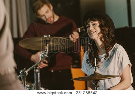 View Of Happy Young Female Drummer On Repetition