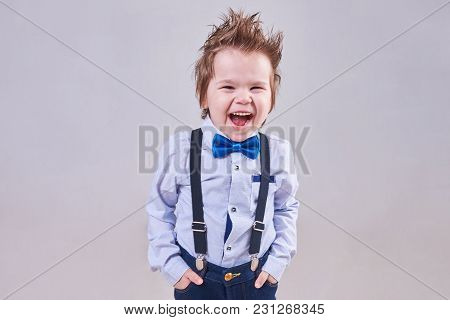 The Little Boy Screams And Smiles In A Blue Bow Tie And Suspenders,for Any Purpose