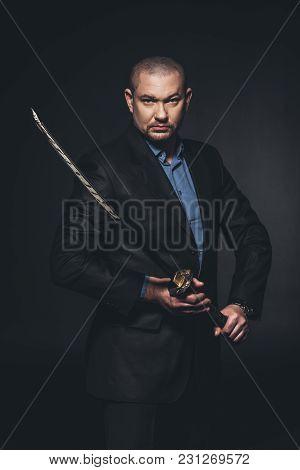 Modern Samurai With Katana Sword On Black