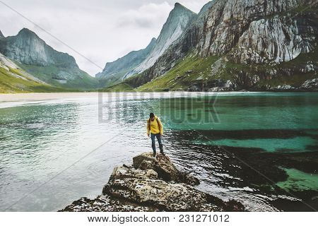 Traveler Man Standing Alone At Sea Stone Travel Lifestyle Adventure Concept Adventure Outdoor Active