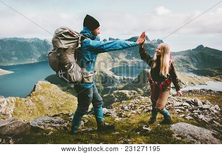 Happy Couple Friends Giving Five Hands On The Top Of Mountain Travel Lifestyle Positive Emotions Con
