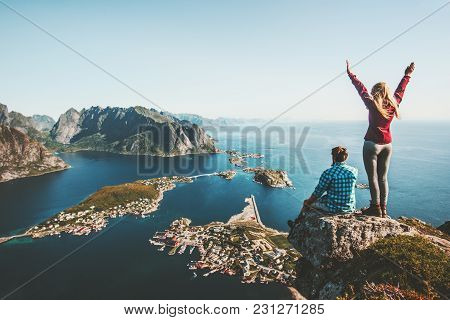 Couple Family Traveling Together On Cliff Edge In Norway Man And Woman Lifestyle Concept Summer Vaca