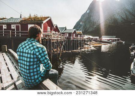 Traveler Man Relaxing Alone On Bridge Sightseeing Reine Village View In Norway Lifestyle Adventure O