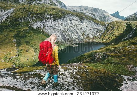 Woman Hiker With Backpack Trekking At  Mountains Lake Traveling Healthy Lifestyle Adventure Concept