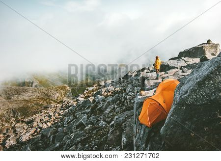 Camping On The Top Of Mountain Tent On Rocky Cliff And Traveler Alone Enjoying Landscape Aerial View