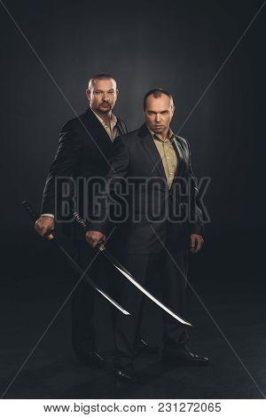 Businessmen With Katana Swords Isolated On Black