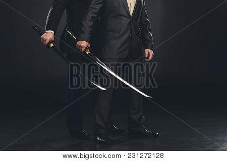 Cropped Shot Of Yakuza Members With Katana Swords Isolated On Black