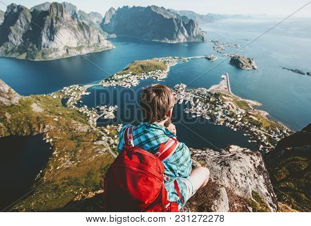 Backpacker Man Sitting On Cliff Edge Relaxing Lifestyle Travel Adventure Outdoor Summer Vacations Ae