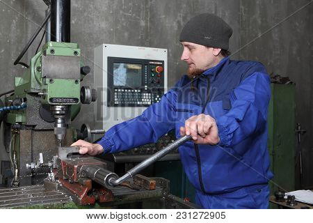 St. Petersburg, Russia - May 30, 2017: Factory Worker Set Up Metal Working Part Into Cnc Punching, M