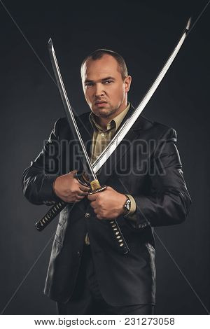 Angry Man In Suit With Katana Sword Isolated On Black