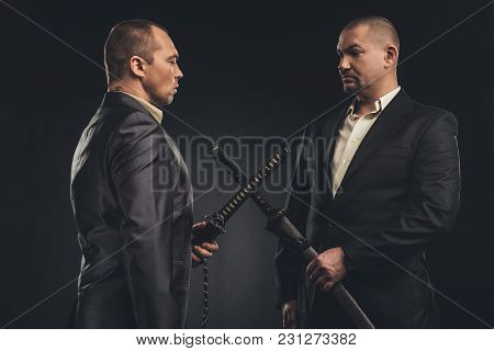 Meeting Of Modern Samurai In Suits With Katana Swords Isolated On Black