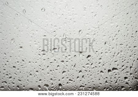 Background In The Form Of A Window Glass With Raindrops