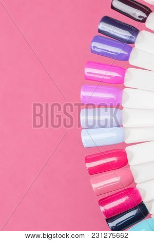 a collection of samples of varnish for manicure. well-groomed hands, healthy nails. Copy space.Finger nail art design samples. poster