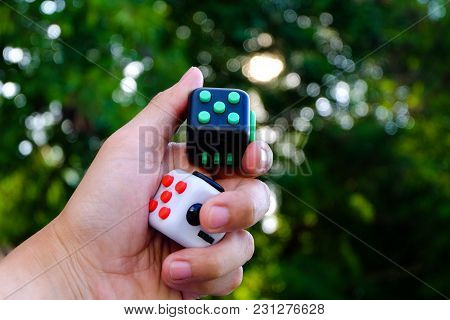 Fidget Cube Stress Reliever, Fingers Toy In Bokeh Background, White And Black. (relax)