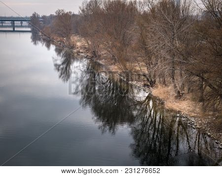 River Danube (neue Donau, Vienna Austria) With Trees Reflecting In The Water