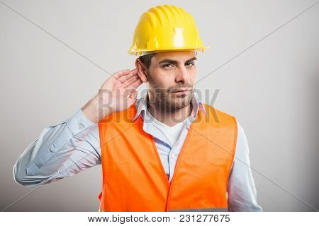 Portrait Of Young Architect Making Can't Hear Gesture