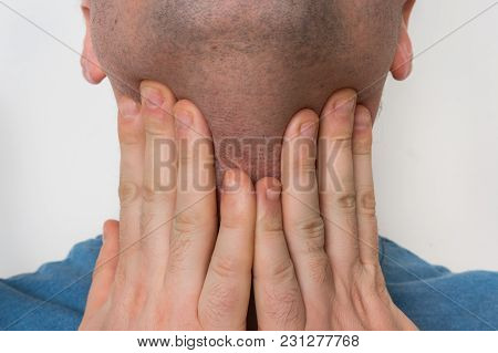 Man With Throat Sore Is Holding His Aching Throat - Body Pain Concept