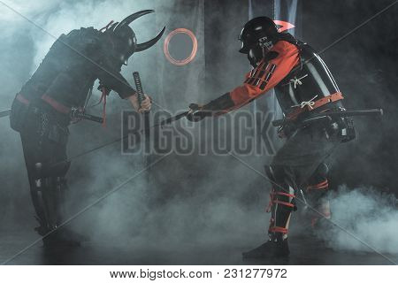 Armored Samurai Fighting With Swords Surrounded With Smoke In Front Of Clan Flags