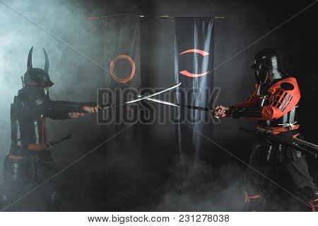 Samurai Warriors Crossing Katana Swords In Front Of Clan Symbols
