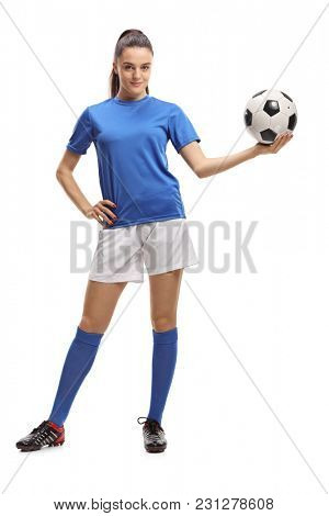 Full length portrait of a female soccer player holding a football isolated on white background