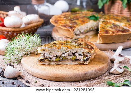 Savory Tart With Chicken, Mushrooms And Cheese On The Wooden Table