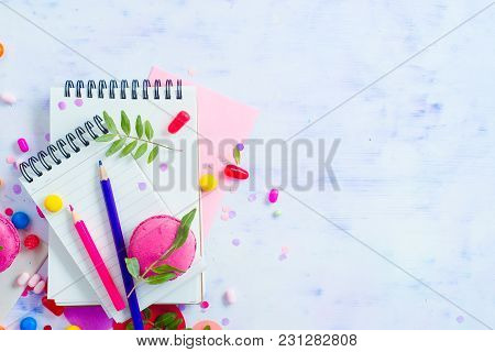 Blank Lined Notepads With Colorful Pencils, Sweets And Pink Macaron Cookie On A Light Background Wit