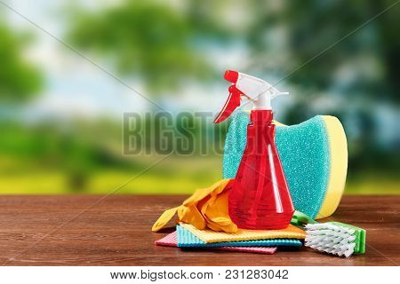 Image With Various Tools For Cleaning The Premises And Cleaning Agents On A Blurred Natural Backgrou