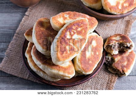 Fried Patties With The Meat In The Plate On Wooden Background