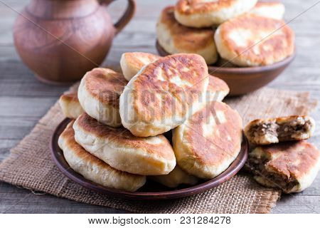Fried Patties With The Meat In The Plate On Old Wooden Background