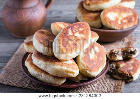 Fried Patties With The Meat In The Plate On Wooden Table, Rustic Style