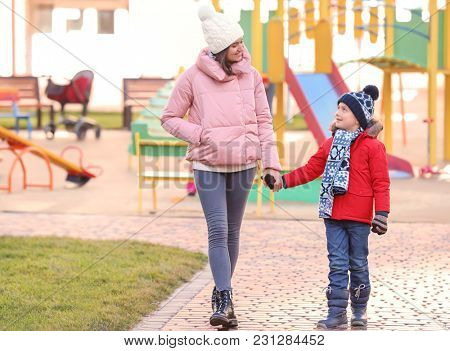 Young woman with little boy outdoors. Child adoption