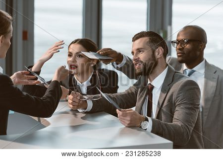 Group Of Businesspeople Having Argument With Airport Receptionist