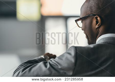 Close-up Shot Of Handsome Businessman Looking At Watch