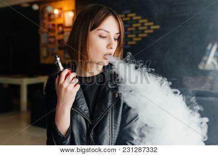Portrait Of Cute Young Vaping Girl. Vapor Concept. Vaping E-cigarette