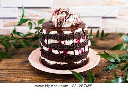 Dark Chocolate Layered Cake With Whipped Mascarpone Cream, Chocolate Sauce, Cherry Syrup Decorated W