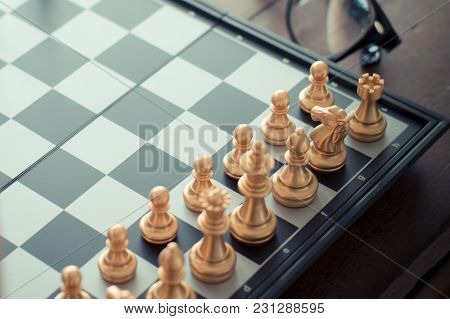 Chess Pieces Setting On Chessboard Game Selective Focus Vintage Style.
