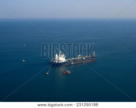 Ship, A Fishing Boat, On The Calm Blue Surface Of The Sea, Small Fishing Boats Around.