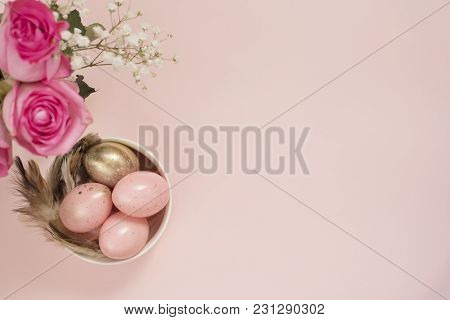 Pink And Gold Easter Eggs. Pastel Easter Concept With Eggs, Flowers And Feathers. Punchy Pastels