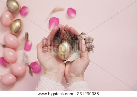 Female, Woman Hands Holding An Easter Egg. Pink And Gold Easter Eggs. Pastel Easter Concept With Egg