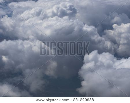 Huge Cumulus Clouds High In The Stratosphere.
