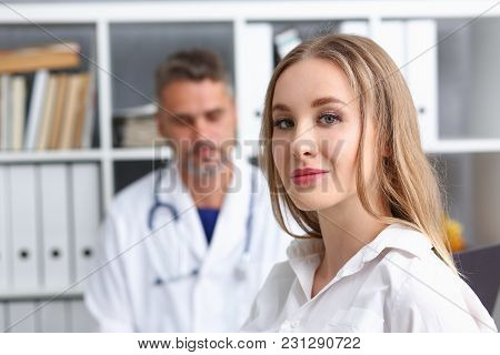 Satisfied Happy Beautiful Smiling Female With Doctor At His Office. High Level And Quality Medical S
