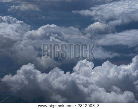 Cumulus Thunderclouds Of Bluish-colored Stripes High In The Sky.