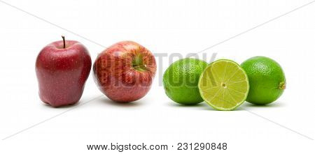 Apples And Lime Isolated On White Background. Horizontal Photo.