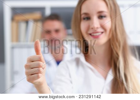 Woman Show Ok Or Confirm With Thumb Up At Doctor Office Portrait. High Level Work Confident Satisfie